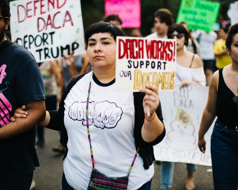 Immigrant rights march. young woman holding sign to support DACA