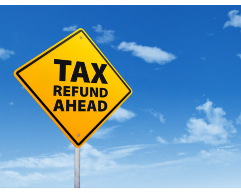 Image of a yellow sigen with TAX REFUND AHEAD